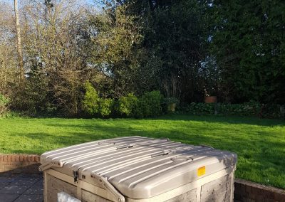 outdoor closed hot tub by hot tub hire