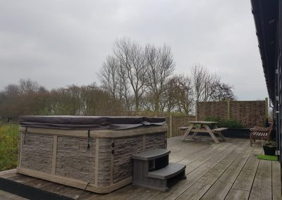 hot tub covered on wooden flooring safe by south east hot tubs