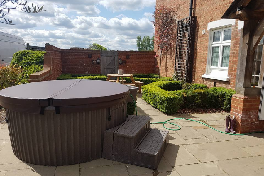 Hot tub with cover for hire by south east hot tubs